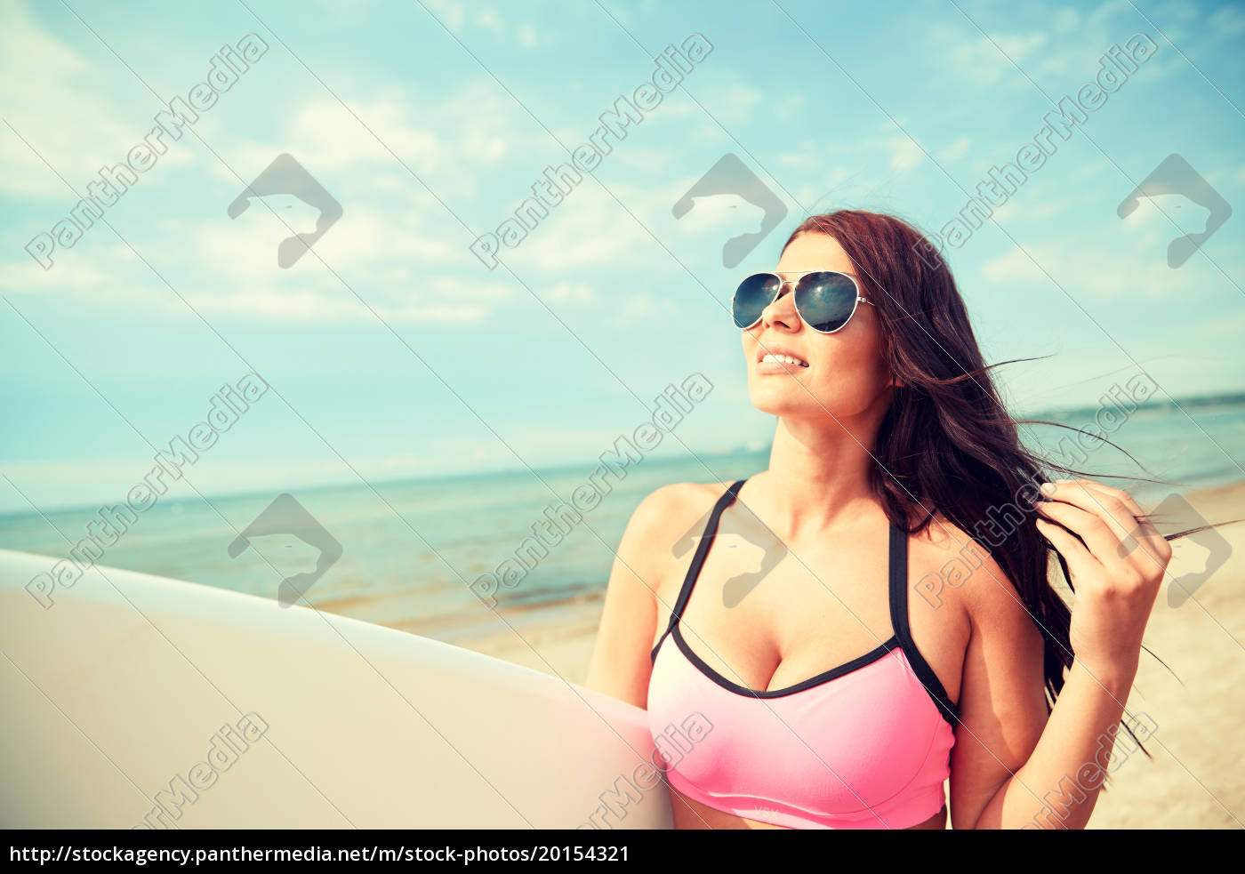 smiling, young, woman, with, surfboard, on - 20154321
