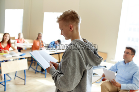 student, boy, with, notebook, and, teacher - 20154237