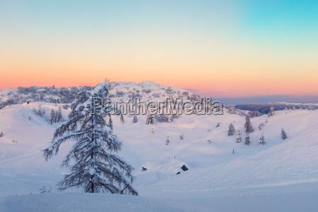 magical sunset winter in julian alps