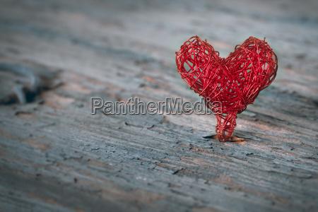 braided heart on a shabby background