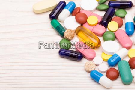 various pills and capsules macro shot