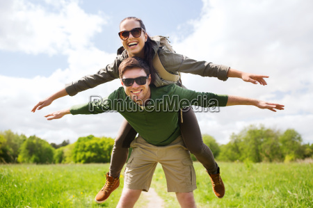 happy couple with backpacks having fun