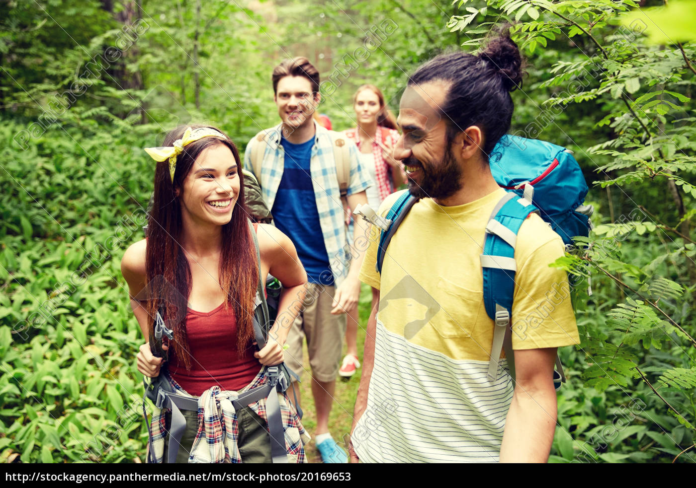 group, of, smiling, friends, with, backpacks - 20169653
