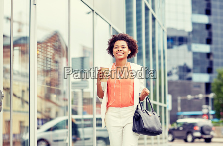 happy, african, businesswoman, with, coffee, in - 20169631