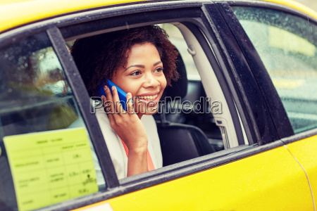 happy, african, woman, calling, on, smartphone - 20169335