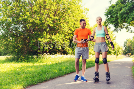 happy, couple, with, roller, skates, riding - 20169331