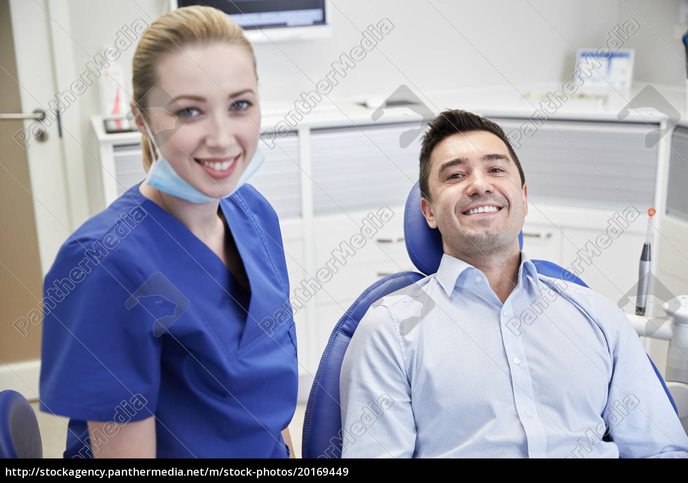 happy, female, dentist, with, man, patient - 20169449