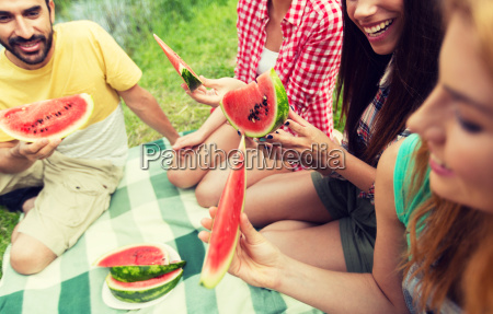 happy, friends, eating, watermelon, at, camping - 20169665