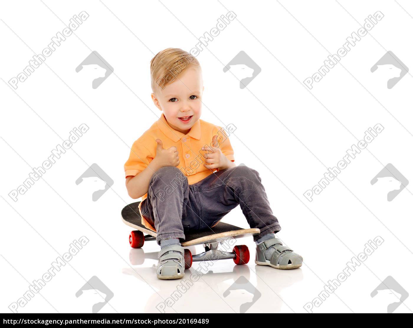 happy, little, boy, on, skateboard, showing - 20169489