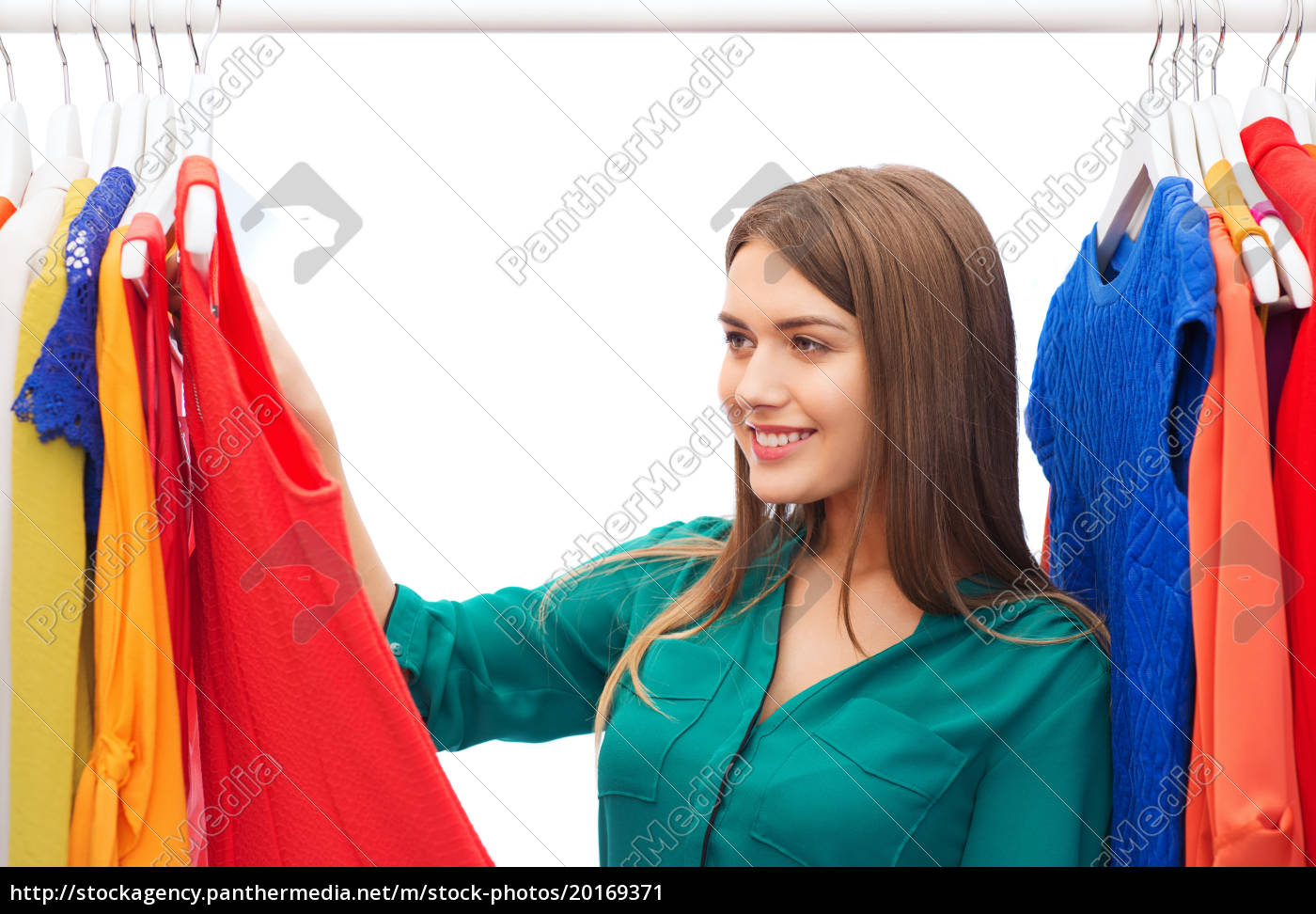 happy, woman, choosing, clothes, at, home - 20169371