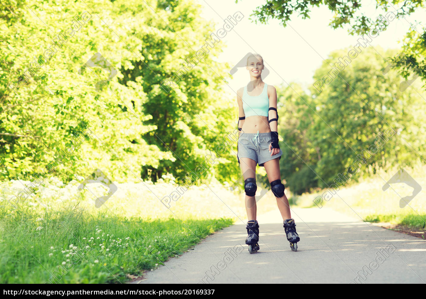 happy, young, woman, in, rollerblades, riding - 20169337