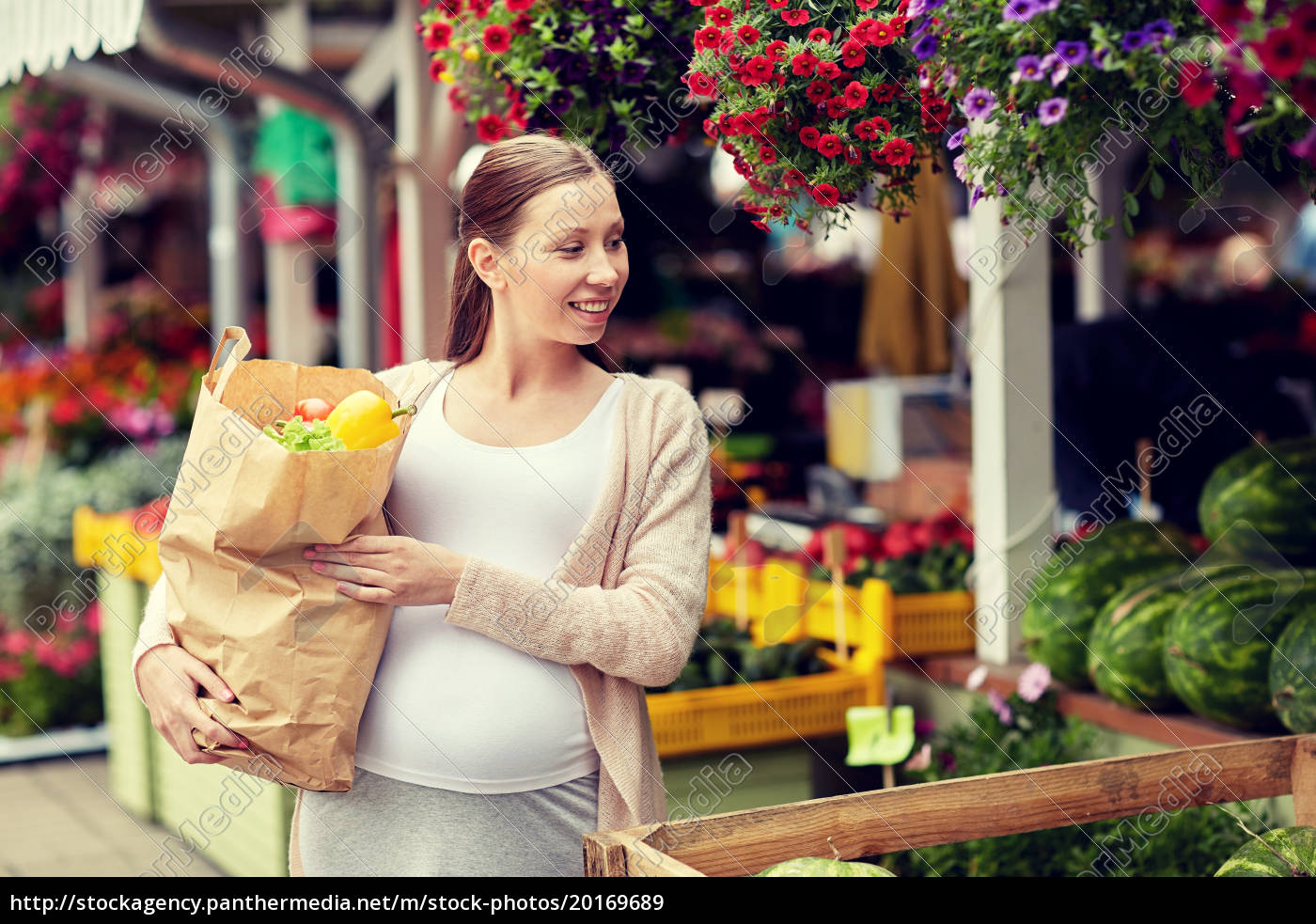 pregnant, woman, with, bag, of, food - 20169689