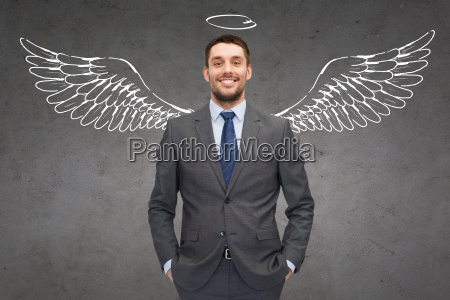 smiling, businessman, with, angel, wings, and - 20169387