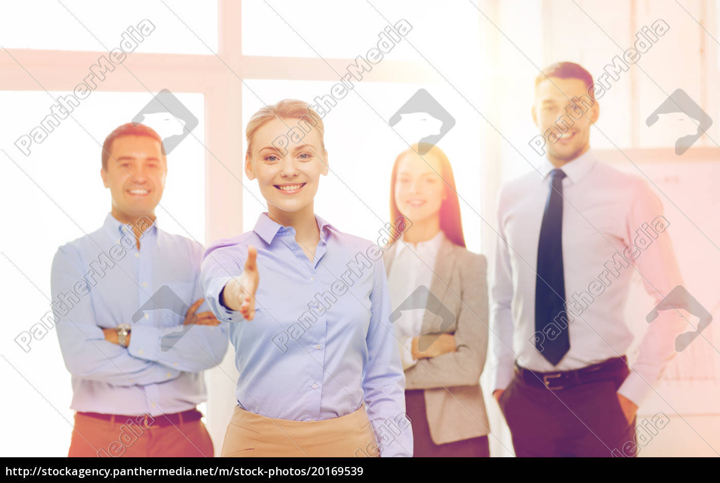 smiling, businesswoman, in, office, with, team - 20169539