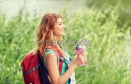 woman, with, backpack, and, bottle, of - 20169501
