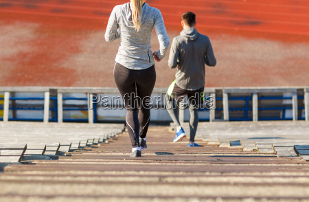 close, up, of, couple, running, downstairs - 20170691