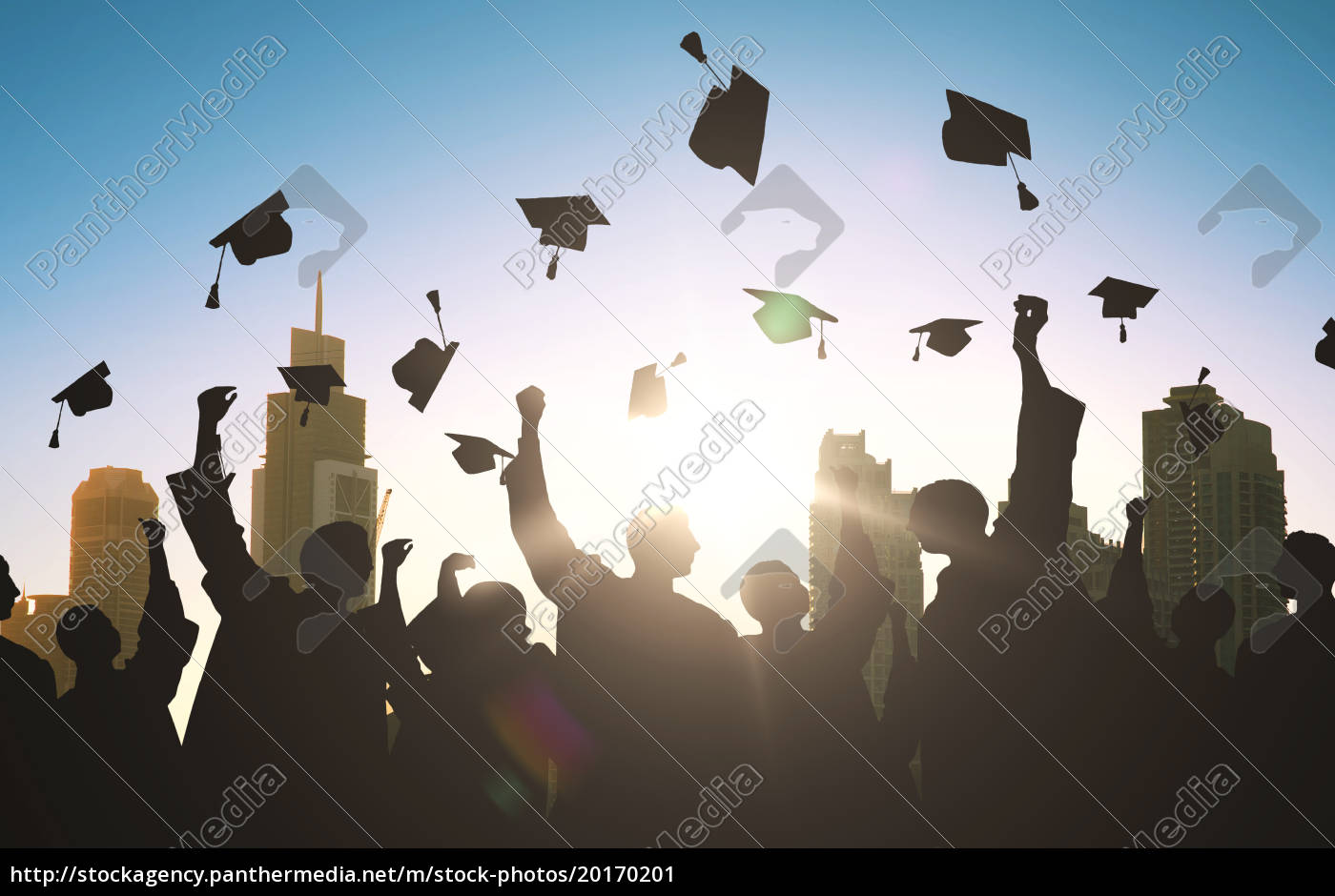 silhouettes, of, students, throwing, mortarboards - 20170201