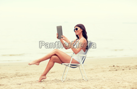smiling, woman, with, tablet, pc, sunbathing - 20170743