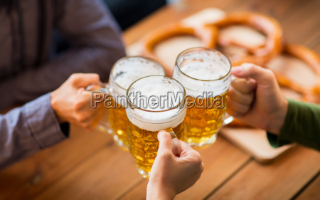 close up of hands with beer
