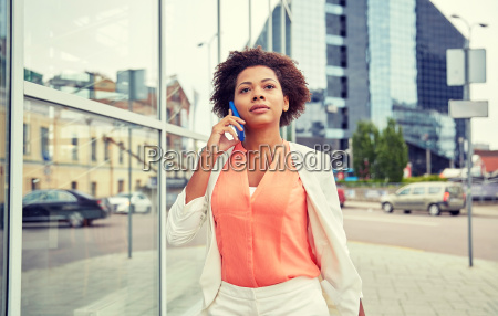 african, businesswoman, calling, on, smartphone - 20171645