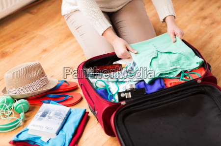 close, up, of, woman, packing, travel - 20171871