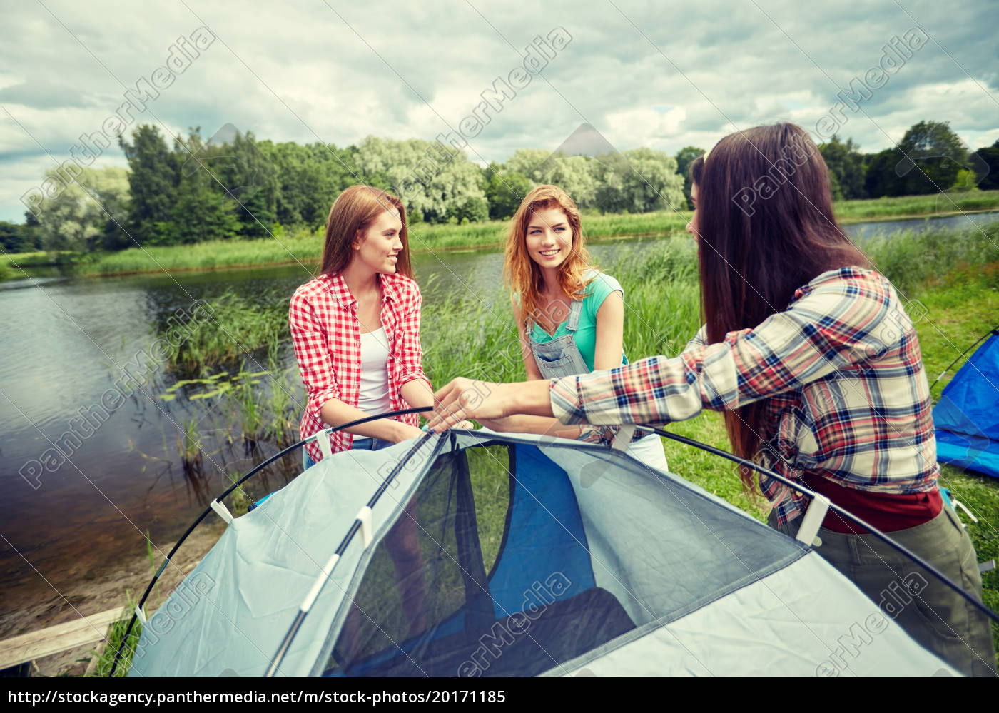 smiling, friends, setting, up, tent, outdoors - 20171185