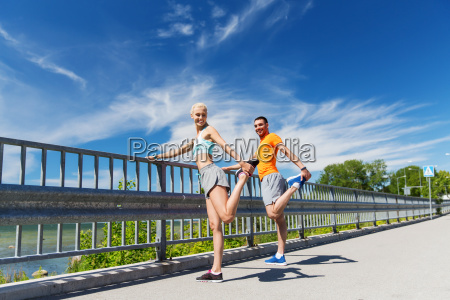 smiling, couple, stretching, outdoors - 20172905