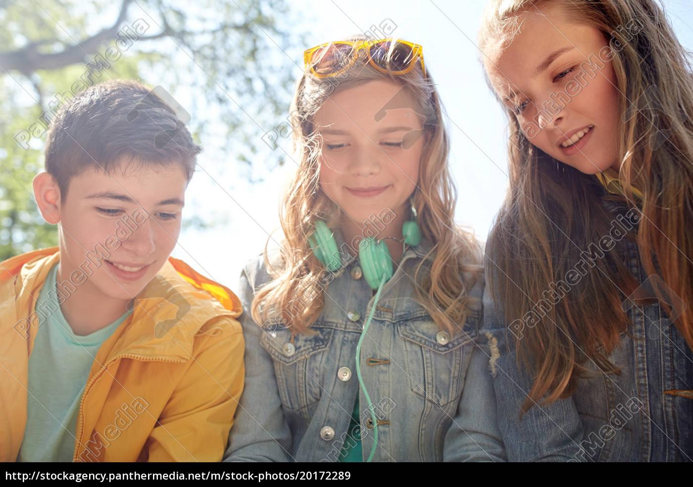 three, happy, teenage, friends, headphones - 20172289