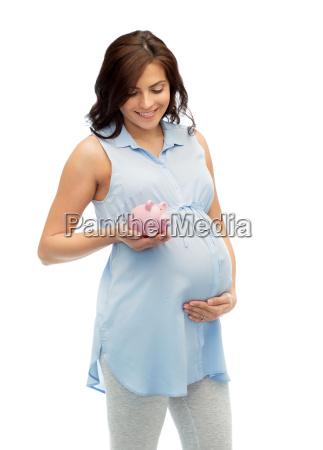 happy, pregnant, woman, with, piggybank - 20173345