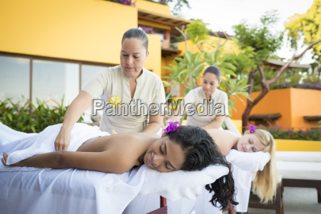 two young women receiving a massage