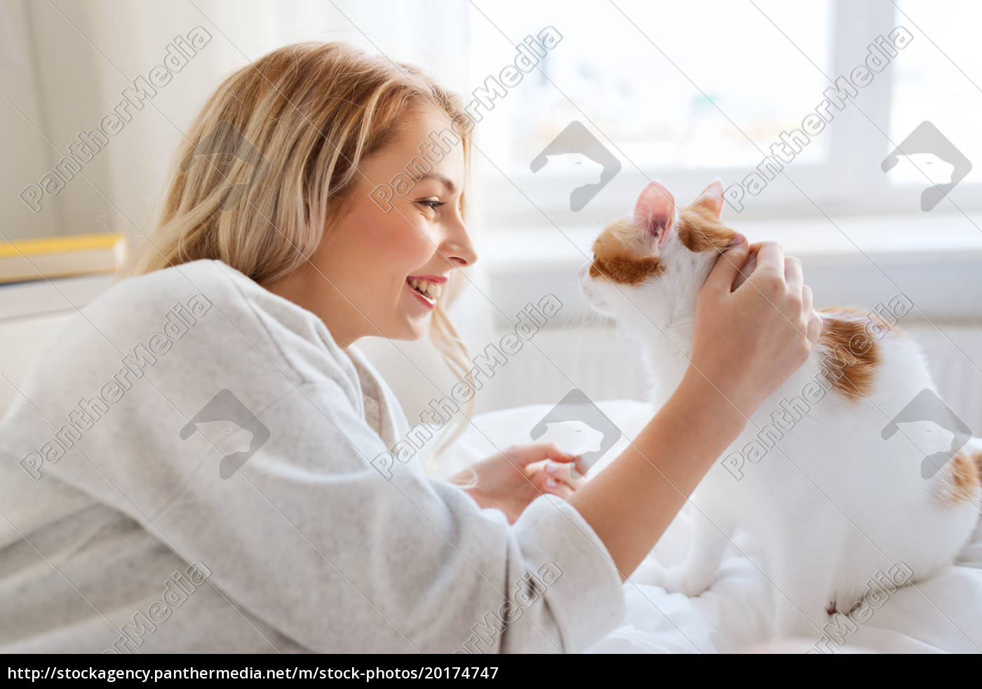 happy, young, woman, with, cat, in - 20174747