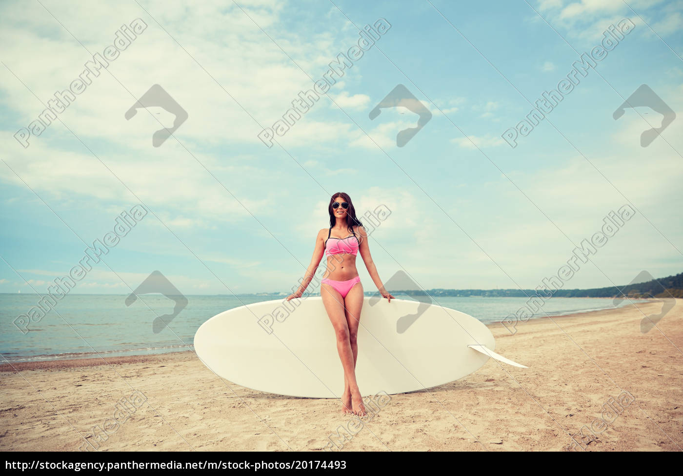 smiling, young, woman, with, surfboard, on - 20174493