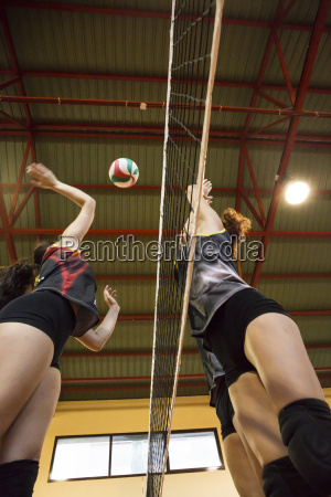 volleyball player spiking the ball during
