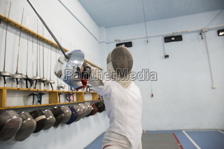 female fencer with weapon