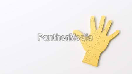 yellow puzzle hand