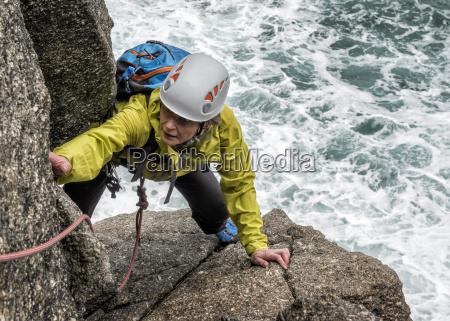 uk cornwall woman climbing on commando