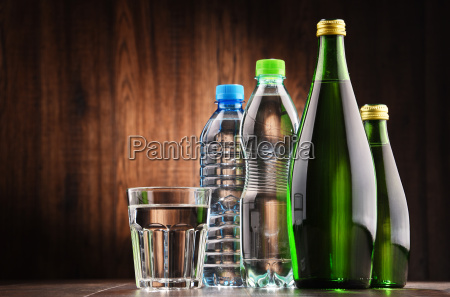 composition with glass and bottles of