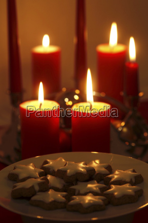 lighted candles and plate of cinnamon