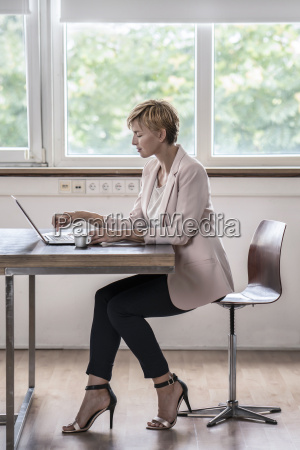 businesswoman using laptop in modern conference