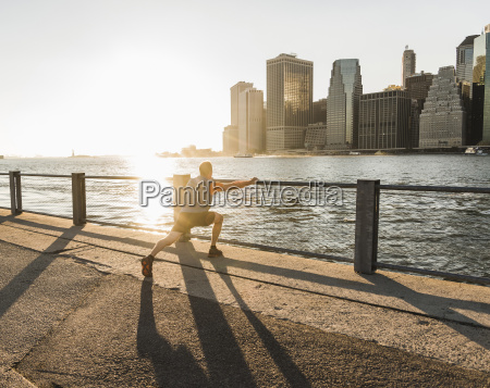 usa brooklyn man doing stretching exercises