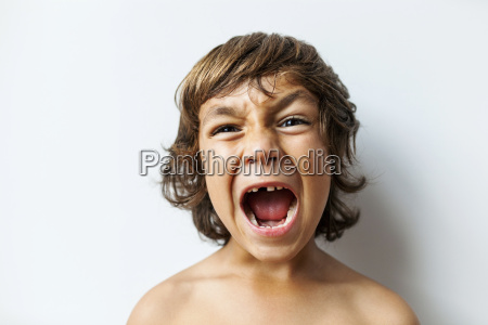 portrait of screaming little boy with