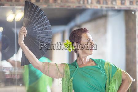smiling female senior latin dancer