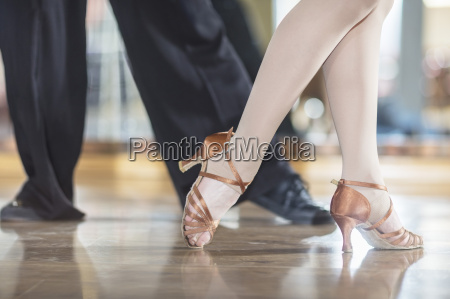 feet of dancing couple in studio