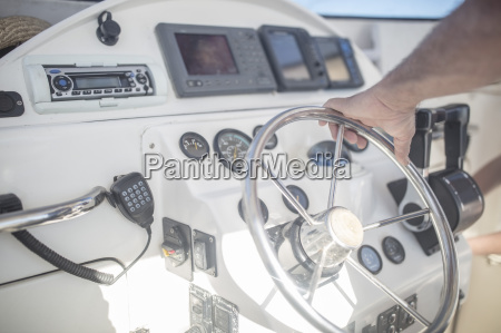 man steering modern fishing boat