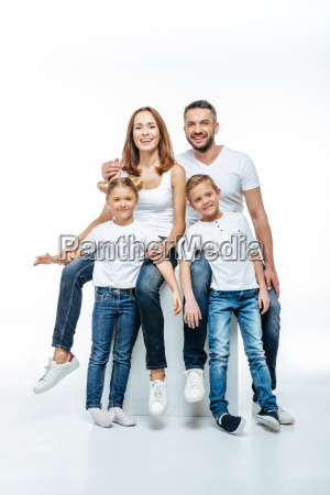 happy parents with children in white