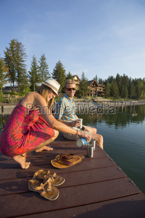 couple hanging out on a dock