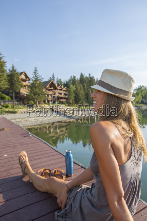 happy woman sitting on the wooden