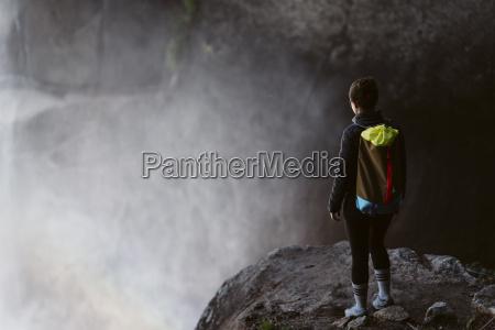 woman standing on rock at yosemite