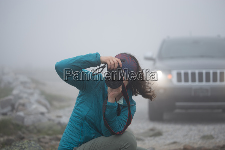 female photographer taking picture on mount