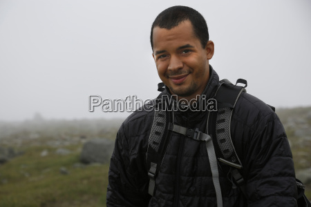 portrait of smiling male photographer on